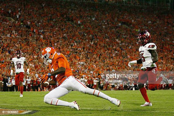 Deon Cain of the Clemson Tigers catches a second quarter touchdown reception under pressure from Trumaine Washington of the Louisville Cardinals at...