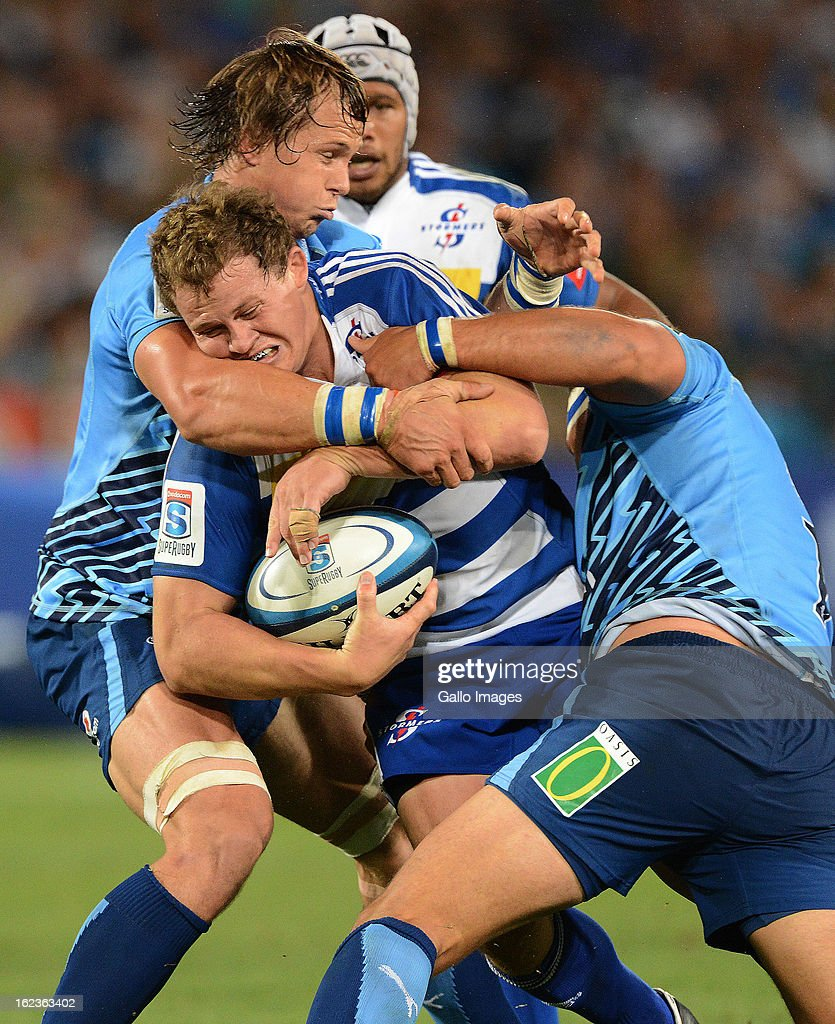 Deon Fourie of the Stormers gets tackled during the Super Rugby match between Vodacom Bulls and DHL Stormers from Loftus Versfeld Stadium on February 22, 2013 in Pretoria, South Africa.