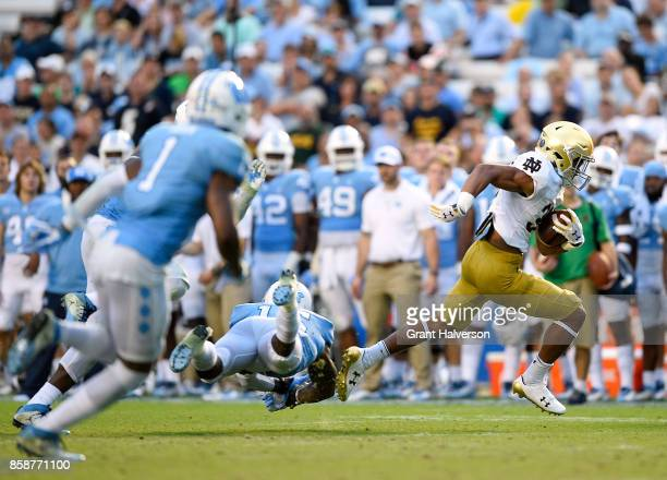 Deon McIntosh of the Notre Dame Fighting Irish breaks away for a touchdown against the North Carolina Tar Heels during the game at Kenan Stadium on...