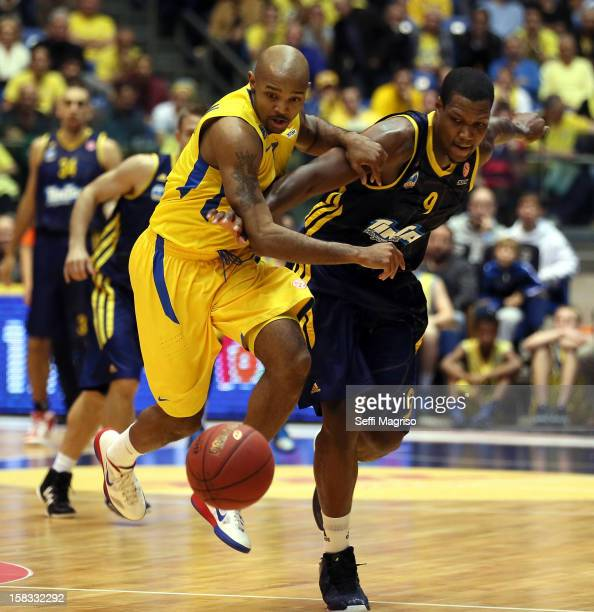 Deon Thompson #9 of Alba Berlin competes with Ricky Hickman #7 of Maccabi Electra Tel Aviv in action during the 20122013 Turkish Airlines Euroleague...