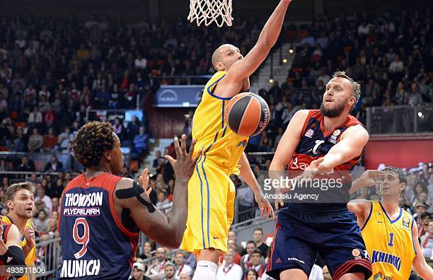 Deon Thompson and Dusko Savanovic of Munich and James Augustine of Moscow fight for the ball during the Euroleague Basketball match between Bayern...