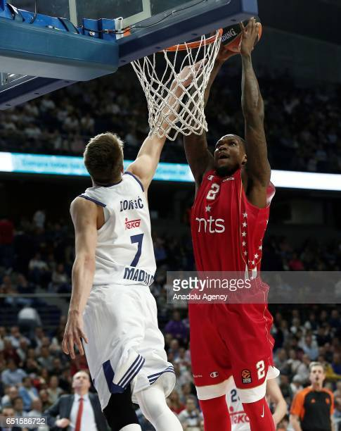 Deon Thompson of Crvena zvezda in action against Luka Doncic of Real Madrid during the Turkish Airlines Euroleague basketball match between Real...