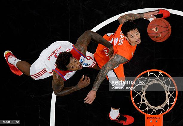 Deon Thompson of FC Bayern Muenchen and Chris Babb of Ulm look for the ball during the Eurocup Basketball match between ratiopharm Ulm and FC Bayern...