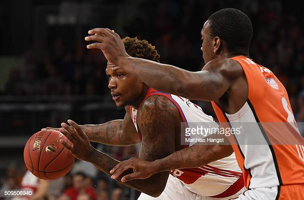 Deon Thompson of FC Bayern Muenchen is challenged by Raymar Morgan of Ulm during the Eurocup Basketball match between ratiopharm Ulm and FC Bayern...