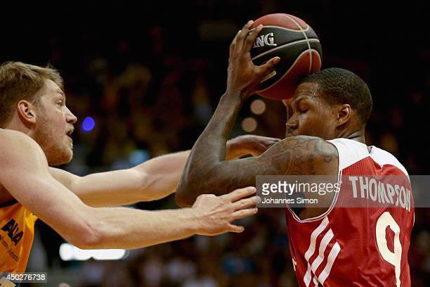 Deon Thompson of Muenchen fights for the ball with JanHendrik Jagla of Berlin during the Beko BBL Playoff Final Game 1 between FC Bayern Muenchen and...