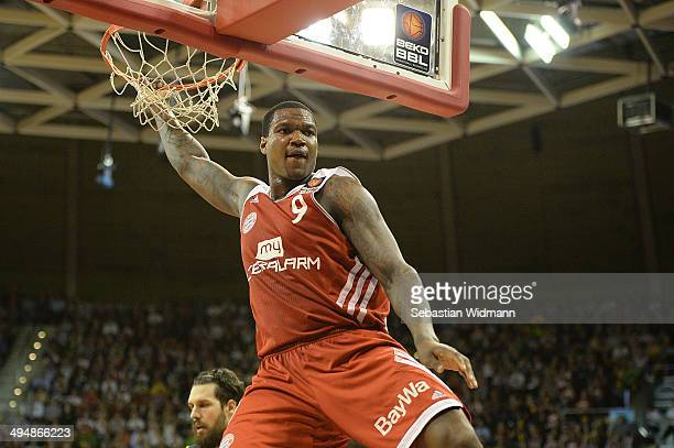 Deon Thompson of Munich hangs on the rim during game three of the 2014 Beko BBL Playoffs SemiFinal between FC Bayern Muenchen and EWE Baskets...