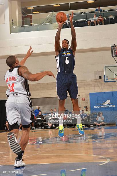 Deon Thompson of the Memphis Grizzlies takes a shot against the Houston Rockets during the Samsung NBA Summer League 2014 on July 10 2014 at Amway...
