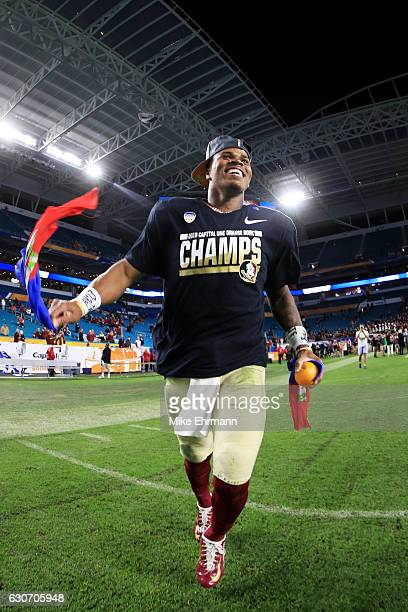 Deondre Francois of the Florida State Seminoles celebrates their 33 to 32 win over the Michigan Wolverines during the Capitol One Orange Bowl at Sun...