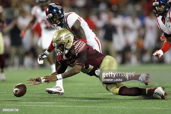 Deondre Francois of the Florida State Seminoles dives on the ball after a fumble in the first half against the Mississippi Rebels during the Camping...