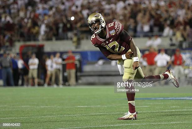 Deondre Francois of the Florida State Seminoles reacts in the second half against the Mississippi Rebels during the Camping World Kickoff at Camping...