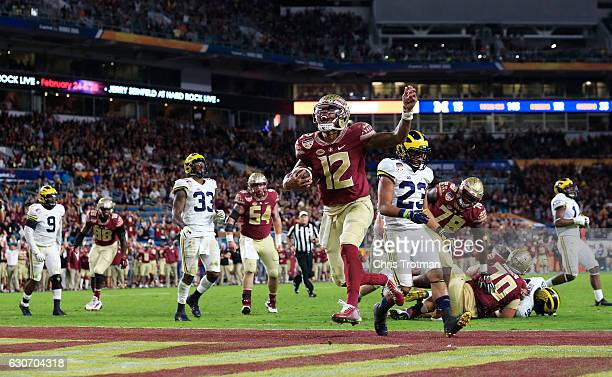 Deondre Francois of the Florida State Seminoles scores a touchdown in the fourth quarteragainst the Michigan Wolverines during the Capitol One Orange...