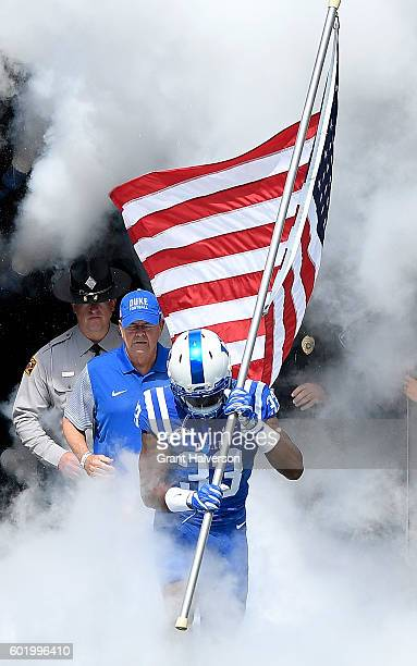 Deondre Singleton of the Duke Blue Devils leads tne team onto the field before their game against the Wake Forest Demon Deacons at Wallace Wade...