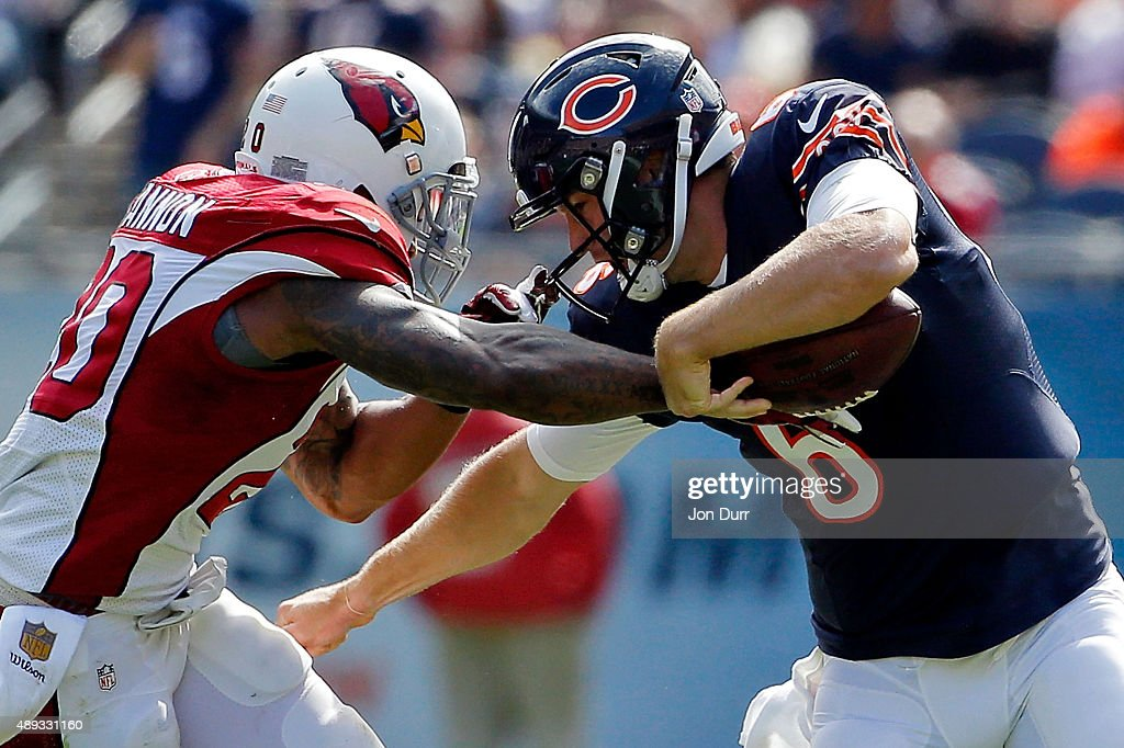 Deone Bucannon of the Arizona Cardinals forces a fumble on Jay Cutler of the Chicago Bears during the second quarter at Soldier Field on September 20...