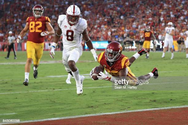 Deontay Burnett of the USC Trojans dives into the end zone during the second quarter to score a touchdown against the Stanford Cardinal at Los...