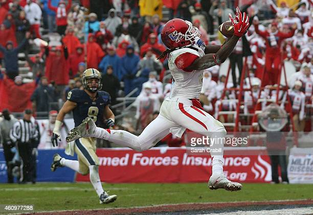 Deontay Greenberry of the Houston Cougars scores the final touchdown during the Lockheed Martin Armed Forces Bowl game against the Pittsburgh...