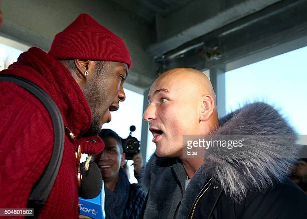 Deontay Wilder and Artur Szpilka exchange words during a portrait and media availability on the terrace at Four World Trade Center on January 13 2016...