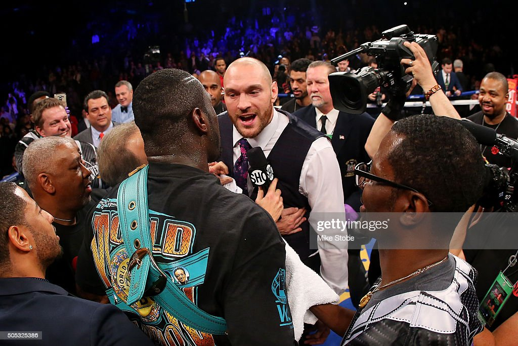 Deontay Wilder and Heavyweight Champion Tyson Fury exchange words after defeating Artur Szpilka at Barclays Center on January 16, 2016 in Brooklyn borough of New York City.