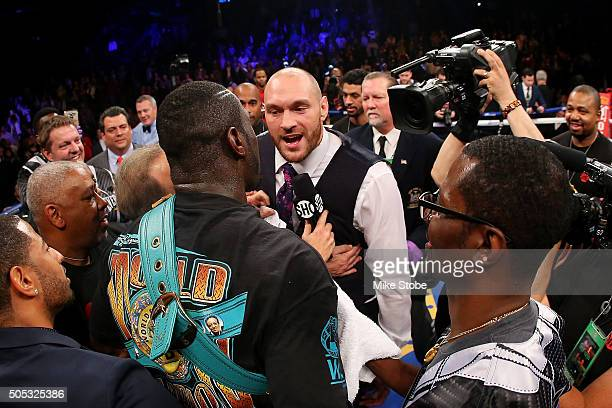 Deontay Wilder and Heavyweight Champion Tyson Fury exchange words after defeating Artur Szpilka at Barclays Center on January 16 2016 in Brooklyn...