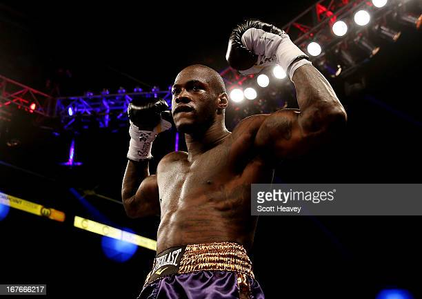 Deontay Wilder celebrates after Knocking down Audley Harrison down during their Heavyweight at Motorpoint Arena on April 27 2013 in Sheffield England