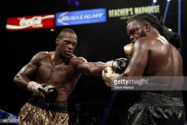 Deontay Wilder connects on WBC heavyweight champion Bermane Stiverne during their title fight at the MGM Grand Garden Arena on January 17 2015 in Las...