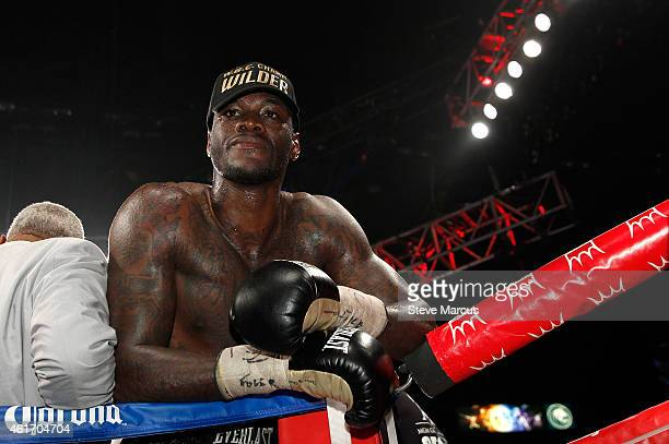 Deontay Wilder poses by his corner after going 12 rounds with WBC heavyweight champion Bermane Stiverne during their title fight at the MGM Grand...
