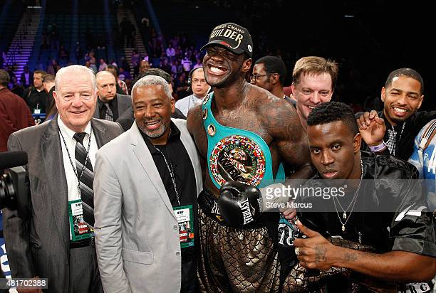 Deontay Wilder poses with members of his camp after defeating WBC heavyweight champion Bermane Stiverne at the MGM Grand Garden Arena on January 17...