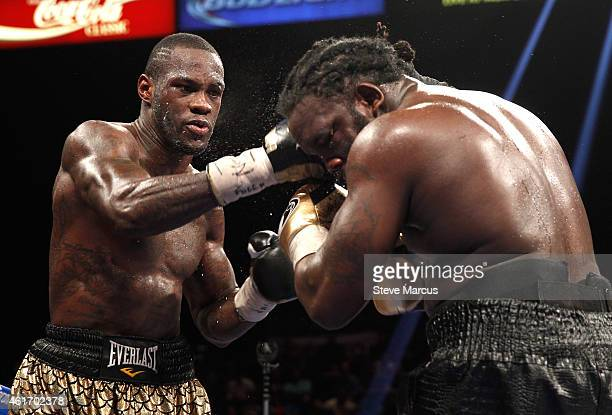Deontay Wilder punches WBC heavyweight champion Bermane Stiverne during their title fight at the MGM Grand Garden Arena on January 17 2015 in Las...