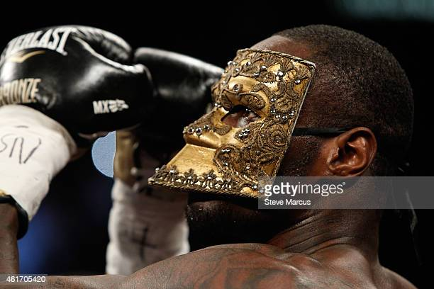 Deontay Wilder wears a mask during his ring entrance for a title fight against WBC heavyweight champion Bermane Stiverne at the MGM Grand Garden...