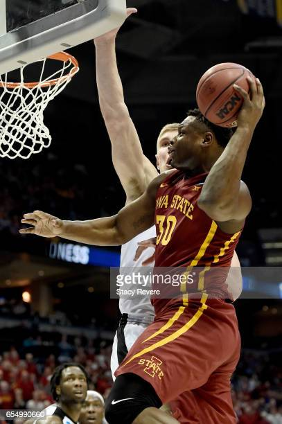 Deonte Burton of the Iowa State Cyclones passes the ball while being guarded by Isaac Haas of the Purdue Boilermakers in the first half during the...