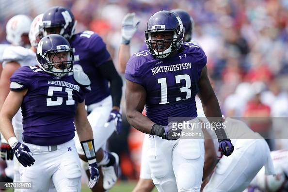 Deonte Gibson of the Northwestern Wildcats celebrates after a tackle for loss against the Stanford Cardinal in the first half at Ryan Field on...