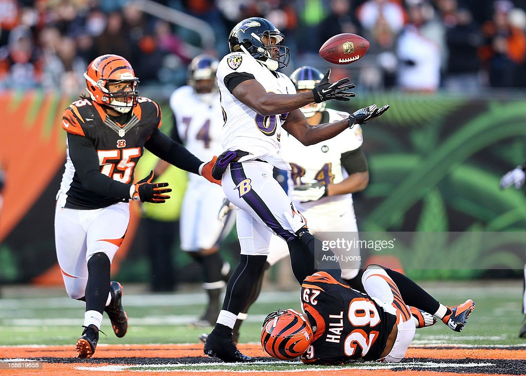 Deonte Thompson #83 of the Baltimore Ravens juggles the ball during the NFL game against the Cincinnati Bengals at Paul Brown Stadium on December 30, 2012 in Cincinnati, Ohio.