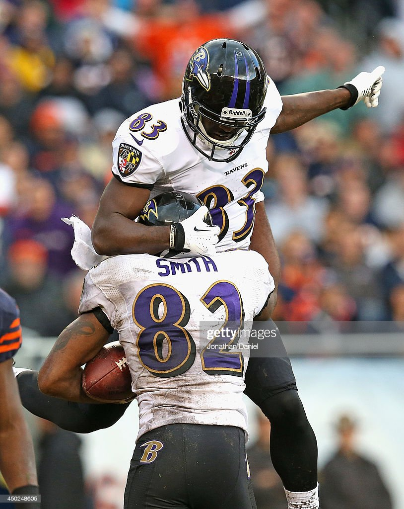 Deonte Thompson #83 of the Baltimore Ravens jumps on teammate Torrey Smith #82 after Smith caught a touchdown pass against the Chicago Bears at Soldier Field on November 17, 2013 in Chicago, Illinois.