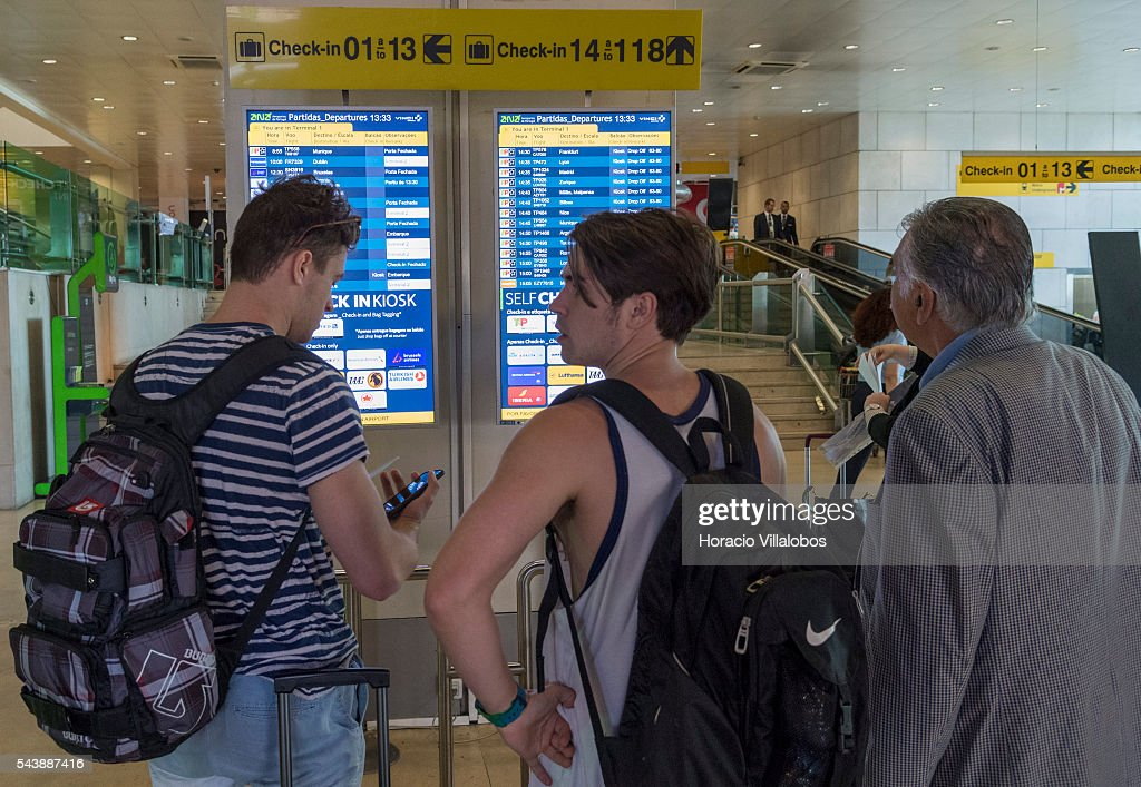 Departing passengers check flight schedules in Terminal 1 of Lisbon Humberto Delgado Airport in a business as usual day after air controllers called off their strike action on June 30, 2016 in Lisbon, Portugal. Although controllers cancelled their labor protest, the airport will suffer a three-days strike, starting on July 1st, staged by luggage handlers, that is supposed to cause a grave disruption.
