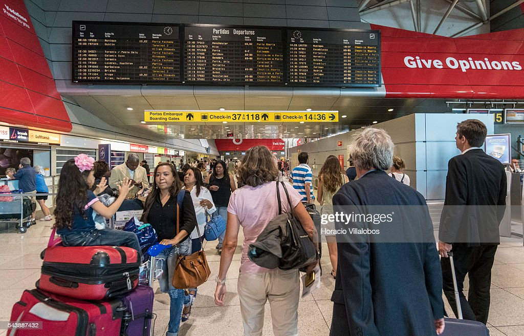 Departing passengers in Terminal 1 of Lisbon Humberto Delgado Airport in a business as usual day after air controllers called off their strike action on June 30, 2016 in Lisbon, Portugal. Although controllers cancelled their labor protest, the airport will suffer a three-days strike, starting on July 1st, staged by luggage handlers, that is supposed to cause a grave disruption.