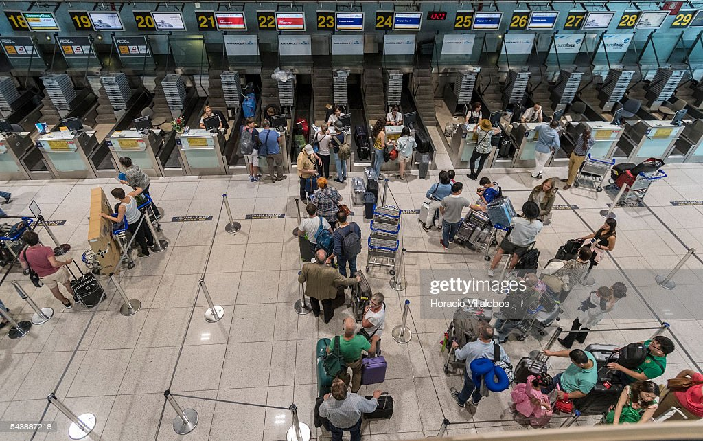 Departing passengers queue before airlines counters in Terminal 1 of Lisbon Humberto Delgado Airport in a business as usual day after air controllers called off their strike action on June 30, 2016 in Lisbon, Portugal. Although controllers cancelled their labor protest, the airport will suffer a three-days strike, starting on July 1st, staged by luggage handlers, that is supposed to cause a grave disruption.