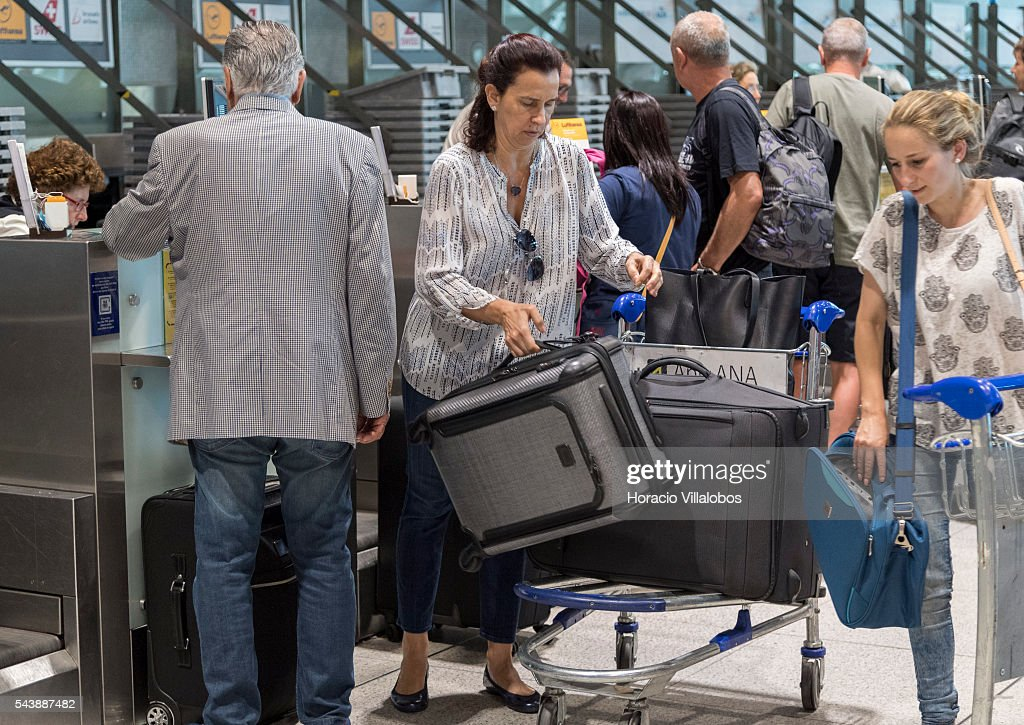Departing passengers seen before airlines counters in Terminal 1 of Lisbon Humberto Delgado Airport in a business as usual day after air controllers called off their strike action on June 30, 2016 in Lisbon, Portugal. Although controllers cancelled their labor protest, the airport will suffer a three-days strike, starting on July 1st, staged by luggage handlers, that is supposed to cause a grave disruption.