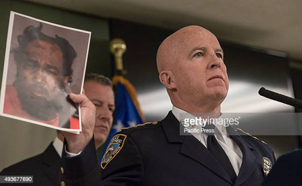 Department Chief James O'Neill makes a brief statement to the press during an offtopic question about an escaped prisoner Gerald Brooks whose image...