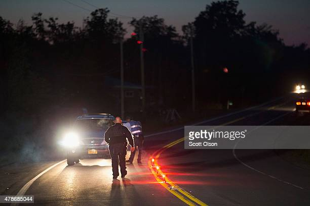 Department of Correction officers man a roadblock near the scene where escaped convict Richard Matt was shot and killed by law enforcement officers...