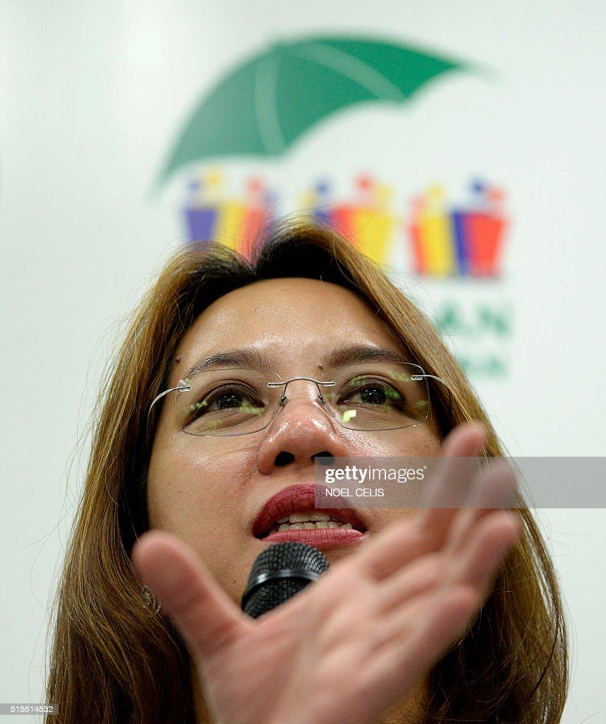 Department of Health secretary Janette Garin gestures ...