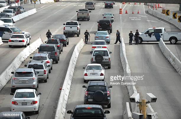 S Department of Homeland Security officers search cars as they enter Mexico from the US at the San Ysidro Port of Entry in San Diego California...