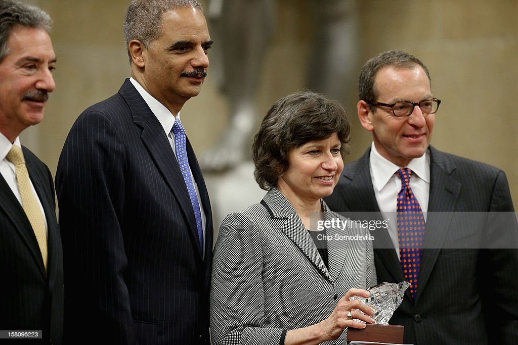 U.S. Department of Justice Appellate Section Deputy Chief Kathleen Felton (2nd R) poses for photographs with (L-R) Deputy Attorney General James Cole, Attorney General <a gi-track='captionPersonalityLinkClicked' href=/galleries/search?phrase=Eric+Holder&family=editorial&specificpeople=1060367 ng-click='$event.stopPropagation()'>Eric Holder</a> and Assistant Attorney General for the Criminal Division <a gi-track='captionPersonalityLinkClicked' href=/galleries/search?phrase=Lanny+Breuer&family=editorial&specificpeople=2591883 ng-click='$event.stopPropagation()'>Lanny Breuer</a> after she was presented with the Petersen Memorial Award during the department's Criminal Division awards ceremony at the Robert F. Kennedy Main Justice Building December 10, 2012 in Washington, DC. Many Justice Department employees, past and present, were given awards for their outstanding public service during 2012.