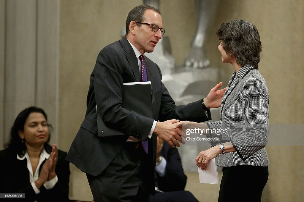 U.S. Department of Justice Appellate Section Deputy Chief Kathleen Felton (R) is congratulated by Assistant Attorney General for the Criminal Division <a gi-track='captionPersonalityLinkClicked' href=/galleries/search?phrase=Lanny+Breuer&family=editorial&specificpeople=2591883 ng-click='$event.stopPropagation()'>Lanny Breuer</a> after she was presented with the Petersen Memorial Award during the department's Criminal Division awards ceremony at the Robert F. Kennedy Main Justice Building December 10, 2012 in Washington, DC. Many Justice Department employees, past and present, were given awards for their outstanding public service during 2012.