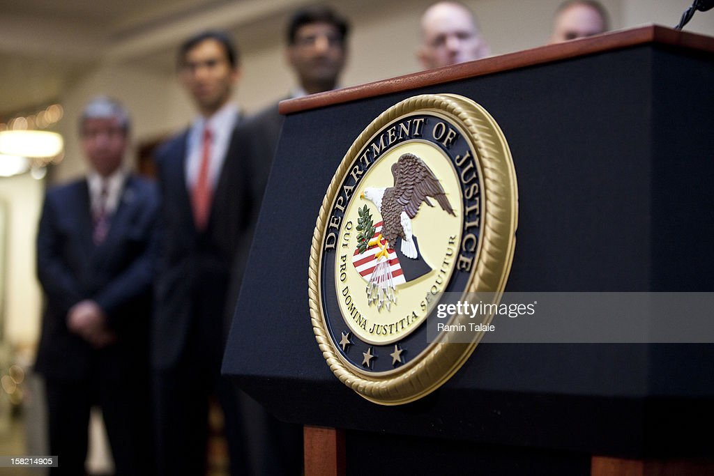 Department of Justice seal is displayed on a podium during a news conference to announce money laundering charges against HSBC on December 11, 2012 in the Brooklyn borough of New York City. HSBC Holdings plc and HSBC USA NA have agreed to pay $1.92 billion and enter into a deferred prosecution agreement with the U.S. Department of Justice in regards to charges involving money laundering with Mexican drug cartels.