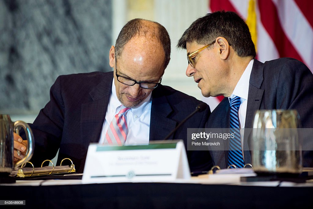U.S. Department of Labor Secretary Thomas Perez and Treasury Secretary Jacob J. Lew confer during a public meeting of the Financial Literacy and Education Commission at the United States Treasury on June 29, 2016 in Washington, DC. The agenda focused on financial education and investment advice, as well as the intersection of financial education and legal aid.