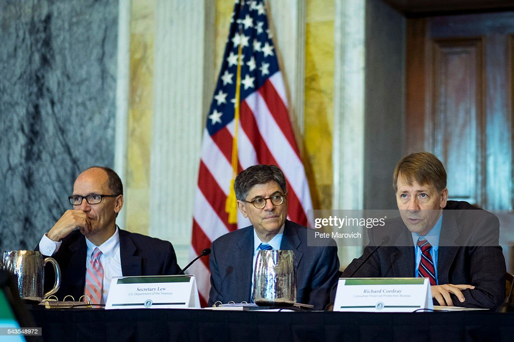 U.S. Department of Labor Secretary Thomas Perez and Treasury Secretary Jacob J. Lew looks on as Director of the Consumer Financial Protection Bureau, <a gi-track='captionPersonalityLinkClicked' href=/galleries/search?phrase=Richard+Cordray&family=editorial&specificpeople=7979683 ng-click='$event.stopPropagation()'>Richard Cordray</a> delivers remarks during a public meeting of the Financial Literacy and Education Commission at the United States Treasury on June 29, 2016 in Washington, DC. The agenda focused on financial education and investment advice, as well as the intersection of financial education and legal aid.