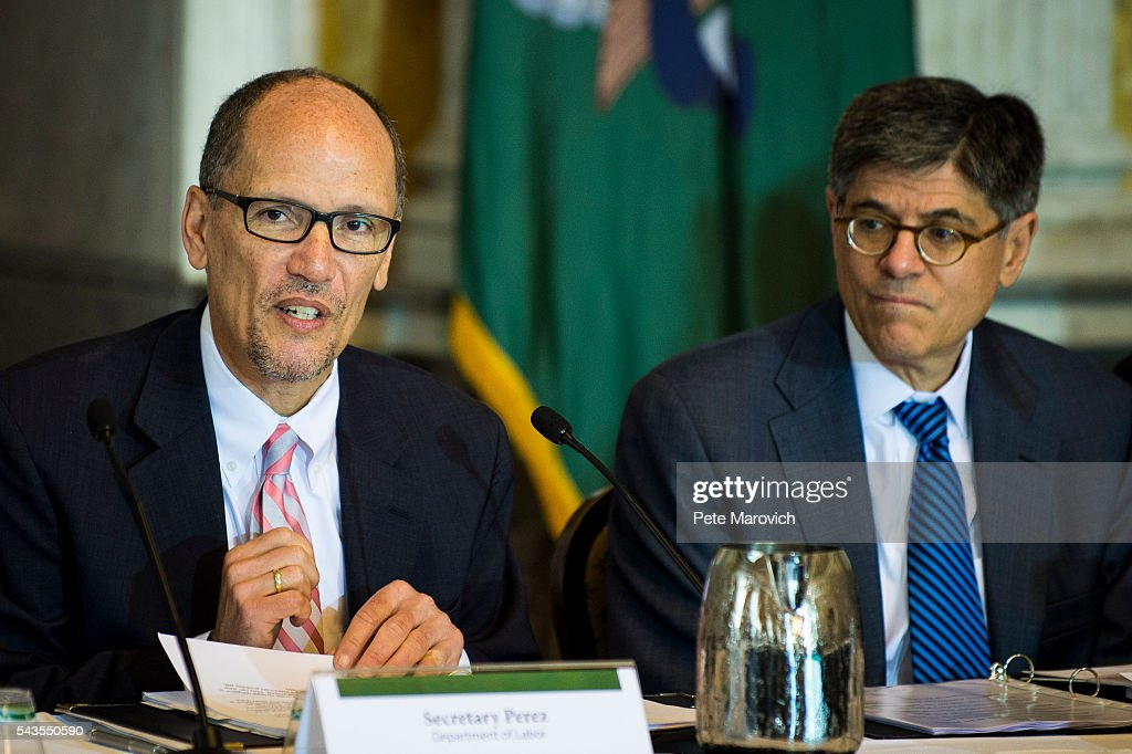 U.S. Department of Labor Secretary Thomas Perez delivers remarks as Treasury Secretary Jacob J. Lew looks on during a public meeting of the Financial Literacy and Education Commission at the United States Treasury on June 29, 2016 in Washington, DC. The agenda focused on financial education and investment advice, as well as the intersection of financial education and legal aid.