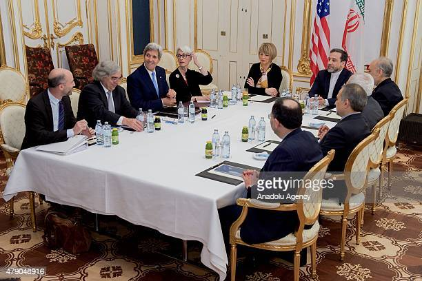 Department of State shows US Secretary of State John Kerry flanked by National Security Council Senior Director for Iran Iraq Syria and the Gulf...