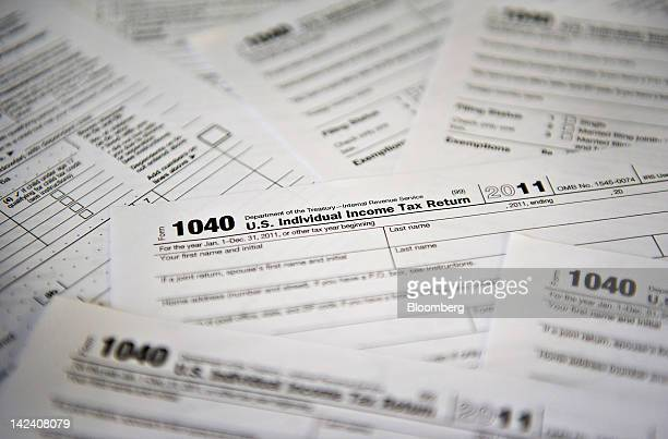 US Department of the Treasury Internal Revenue Service 1040 Individual Income Tax forms for the 2011 tax year are arranged for a photograph in...