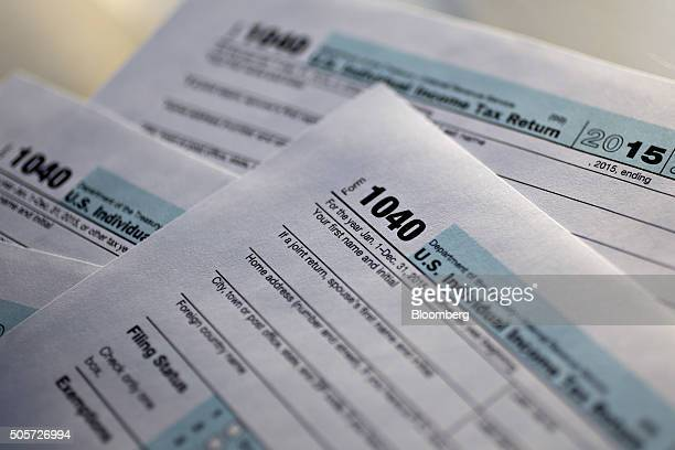 US Department of the Treasury Internal Revenue Service 1040 Individual Income Tax forms for the 2015 tax year are arranged for a photograph in...
