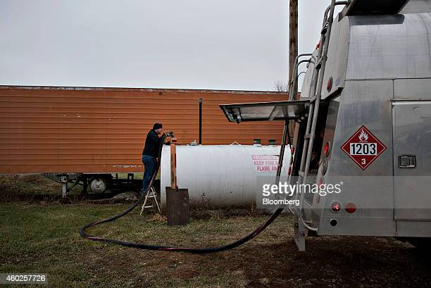 A US Department of Transportation 1203 flammable liquid placard hangs on a delivery truck as Michlig Energy driver Jake Gould delivers diesel fuel to...